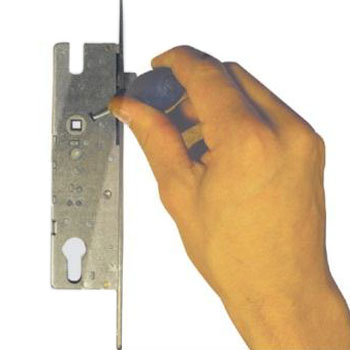 For the night latch reversal you will need to push the small flat screw driver in to the hole pictured